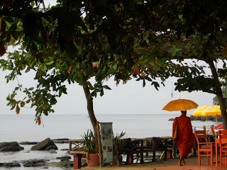 Monk walking down the beach at Sihanoukville