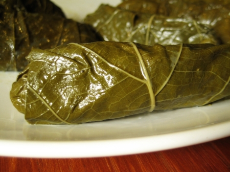 Grape leaf dolma. Photo cred https://www.flickr.com/photos/tofuttibreak/2788936787/in/photolist-5fs2K2-63bXww-hxM1V-grpo8-WA3a6-6sF1qi-WA39r-5fjmQM-6XQj8G-ejEJZX-jdRU5d-7pyE3w-2MTFar-2MXFCh-2MWs9N-8uXyGE-8EGAtU-6sF27F-4YqmPb-5ErbU4-nEXxoa-5gVfTm-4Ym5KR-4YqjGs-4LnWtR-WCrGq-WCrDC-8EGAtQ-4Ym4ue-9b26pa-9b26d4-6sF1Q2-8MzBH8-7pv1LH-7pyRoh-7puWdg-7pyGeb-5YbzyS-hzbo5E-bW2GYY-j2i3nz-d4KQj5-5fjn7t-2yQLFZ-ni8WTc-dJEUjM-4Yqm2q-4YqgiC-mgcLZR-5pTdZr