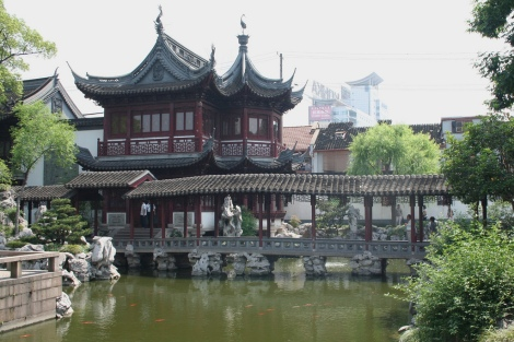 Surrounded by tall buildings, you can visit Yu Yuan garden and experience another time. Photo credit https://www.flickr.com/photos/sarmu/4670828100/in/photolist-87KdsY-8BV5Tx-c68HFd-bUM2Nd-9quAxY-dKTHzU-kAkwRF-5Z2Yvf-bVT2ks-6SKJam-4VEgfW-DK89R-HVgw3-b5Q5rp-bz7jEf-c5M6Z1-qztSb-6zbMiq-e2JWog-5Z2Z1b-dRstt9-89nHeY-7ZhAM1-6Mg7om-3SMN6-33v8om-33qx4x-e4u8zr-5VUjhp-fezCfH-i9AXNh-c7N2mC-eMywTR-74Jk5w-ph8uym-dazQkG-gWwTGg-5Y9cxq-9gppD6-5SDvow-f81gcA-nTnjfm-hmV9Lr-9mnSuL-bVmfDs-cnEQFY-boK4CC-ksUYYF-dULA2k-aQysaK