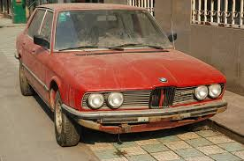 I see old clunkers everywhere. Photo cred http://pixabay.com/en/car-bmw-clunker-old-rusty-red-15927/