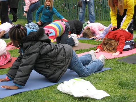 Kids love yoga- especially outside! Photo cred: https://www.flickr.com/photos/creativedc/3438229871/