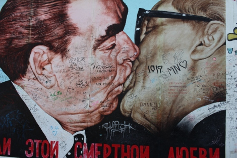 The Kiss depicts Soviet leader Leonid Brezhnev giving the East Germany President Erich Honecker a passionate kiss. Beneath it says,