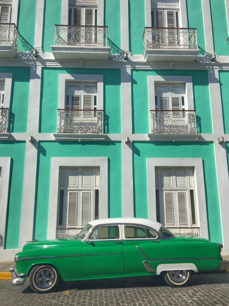 This is one of my favorite shots from my trip. An old car I found in Cienfuegos in front of a beautiful old hotel.